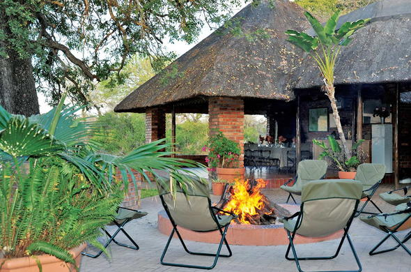 Guests can gather around the Djuma Galago Camp boma before dinner.